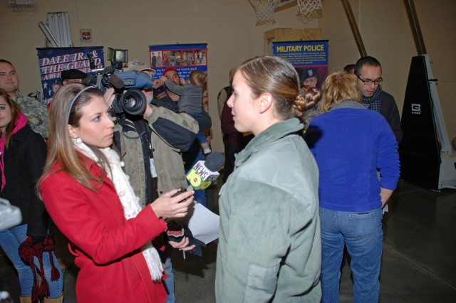 Specialist Ashley Towers from Corinth, NY and assigned for deployment to the Jamaica, Queens-based 442nd Military Police Company now serving in Iraq speaks to reporter Marie Luby from WTEN TV 10 News in Albany, NY just prior to the Annual Christmas Eve Road March in recognition of deployed military personnel over the holiday period.  More than 320 military members from four service branches, veterans, military family members and friends of the community participated