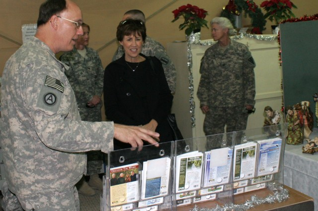 Sheila Casey, an honorary board member of United Service Organizations and wife of Chief of Staff of the Army Gen. George W. Casey Jr., toured the Life Support Area in Kuwait on Christmas Eve to greet servicemembers and spread holiday cheer. While touring the LSA she received a short briefing from the Lt. Col. Gary Taylor, LSA chaplain.