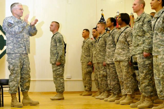 CONTINGENCY OPERATING BASE SPEICHER, Iraq - U.S. Army Chief of Staff Gen. George W. Casey, Jr., applauds Soldiers of Task Force Ironhorse, U.S. Division-North Soldiers immediately following the oath of reenlistment and reaffirmation was given at the north Moral, Welfare, and Recreation center at Contingency Operating Base Speicher, Iraq, Dec. 24, 2010. Casey reenlisted 66 Soldiers from 4th Infantry Division; 4th Advise and Assist Brigade, 1st Cavalry Division; 1st Advise and Assist Brigade, 1st Infantry Division; 2nd Advise and Assist Brigade, 25th Infantry Division; Task Force ODIN (Observe, Detect, Identify, Neutralize) 103rd Expeditionary Sustainment Command, during a Christmas Eve reenlistment and reaffirmation ceremony. Casey made a special visit to northern Iraq to show his appreciation and support for the Soldiers deployed as part of U.S. Division-North in support of Operation New Dawn. Casey reminded the Soldiers who reaffirmed their commitment that they are serving in the greatest Army in the history of the world.