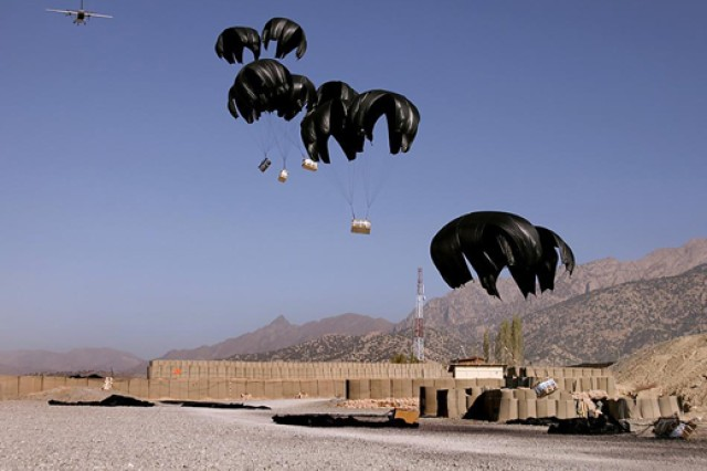 Multiple Low Cost, Low Altitude aerial delivery system bundles land at a Forward Operating Base in Afghanistan.