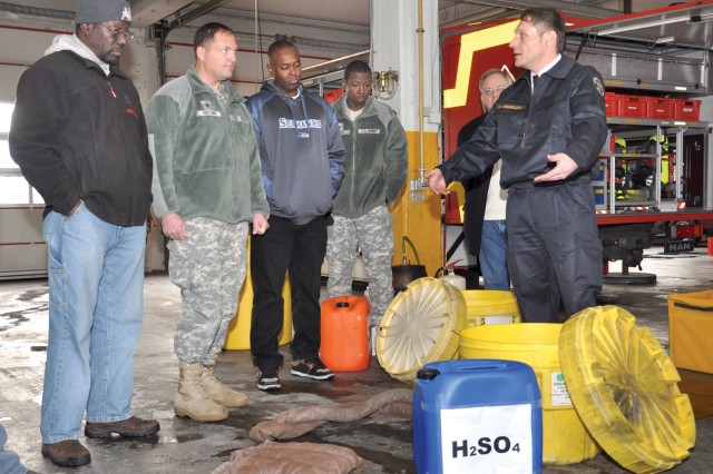 U.S. Army Garrison Wiesbaden Fire Chief Daniel Corzelius describes how to use the various resources in a spill kit at the USAG Wiesbaden Fire Stationi during environmental officer training.