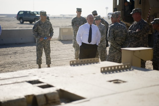 Joseph W. Westphal, the under secretary of the United States Army, speaks with Soldiers during a tour of Camp Arifjan, Kuwait, Dec. 2. was given a firsthand look at the capability of different vehicles used by Third Army. During the tour Westphal was able see to how Third Army not only supports the war fighter but is a war-fighting headquarters.