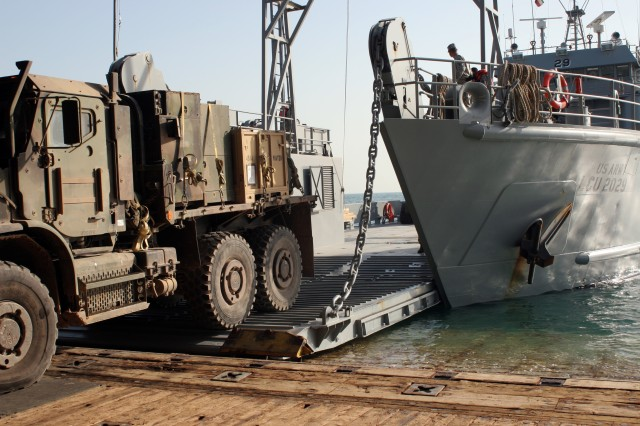 A truck backs onto the LCU-2029, Dec. 23, while at sea off the coast of Camp Patriot, Kuwait.