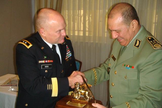 Maj. Gen. David R. Hogg, U.S. Army Africa (USARAF) commander, presents a U.S. Army Africa lion to Algerian Maj. Gen. Ahcene Tafer during a visit to Algiers, Algeria, Dec. 6, 2010.