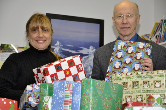 Elke Betters, left, the Family Development Specialist for the City of Watervliet Head Start Program, and Bob Pfeil, Arsenal Museum Curator, pose with several of the gifts collected this year for the local Head Start Program. More than $8,600 of gifts were collected so support 26 families in the Head Start Program.