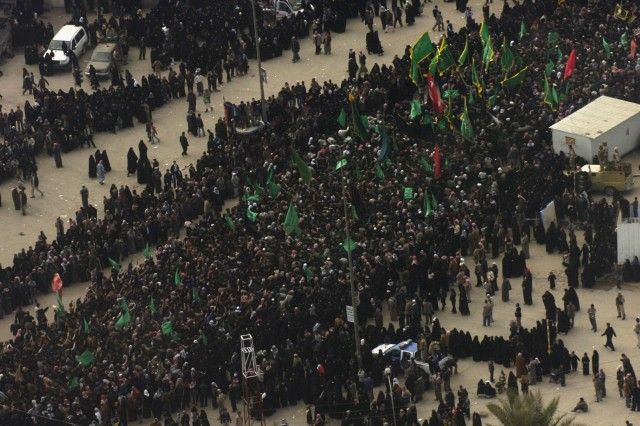 Pilgrims gather in Karbala, Iraq, at a previous commemoration of the Muslim holiday of Ashoura, Jan. 19, 2008. The 10-day event commemorates the death of Imam Hussein, the grandson of the prophet Mohammad, near the city 1,300 years ago. As many as 4 million people participated in the December 2010 holiday, an event for which Iraqi Security Forces took the lead in the protection of participating pilgrims.