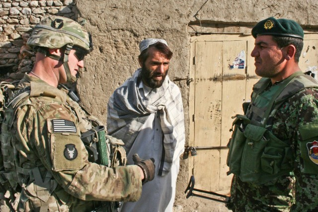 Leaders talking with Afghan citizen