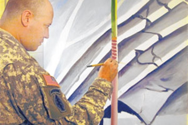 Master Sgt. Martin Cervantez works on a painting of a Haitian hotel that had collapsed during the Haiti earthquake earlier this year.