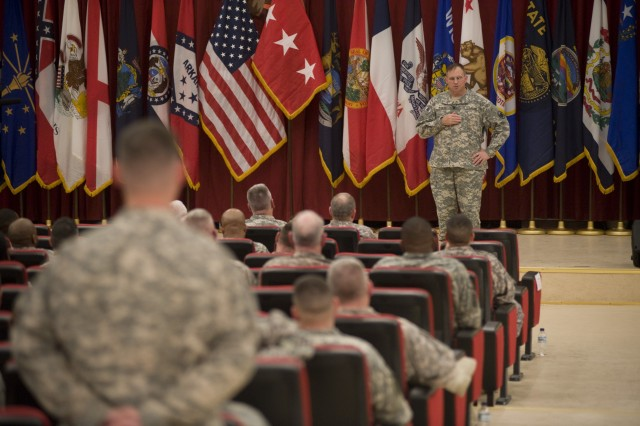 Lt. Gen. Jack C. Stultz, Chief of the Army Reserve (right) answers a question from Capt. Steven Lively, who serves as a supply officer with the 469th Combat Sustainment Support Battalion, during a town hall meeting at Camp Arifjan, Kuwait Dec 28. Lt. Gen Stultz answered questions concerning promotions, job stability back home and predeployment issues. (Photo by Sgt. Ryan Hohman, 27th Public Affairs Detachment)