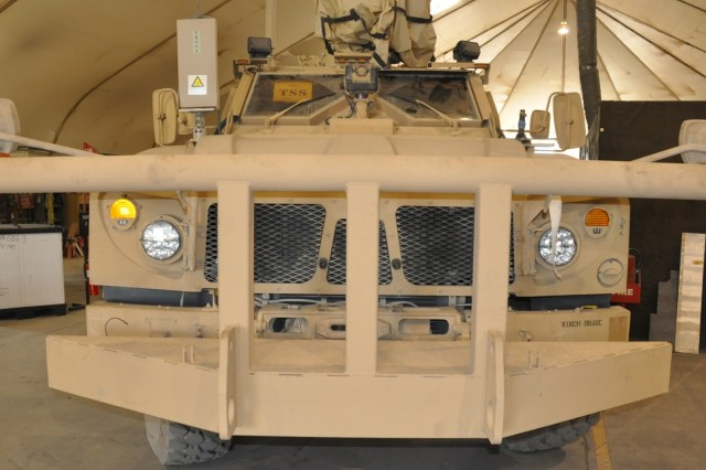 A Bastogne bumper developed in a collaborative effort between two Soldiers from the 426th Brigade Support Battalion, 1st Brigade Combat Team, and the Allied Trades team of AECOM-CACI FIRST contractors, is mounted to the front of a Mine-Resistant, Ambush-Protected All-Terrain Vehicle. The bumper is used to push non-operational vehicles out of the way during convoys in hostile areas.
