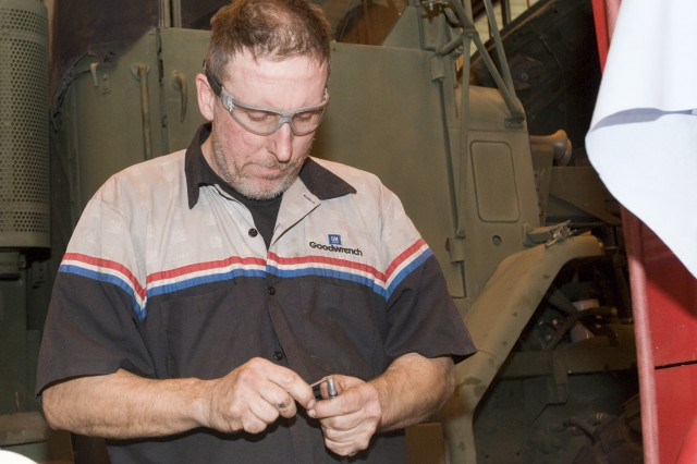 Francis Shoulders works on military vehicle at the 81st Regional Support Command's Equipment Concentration Site 124 on Fort Jackson, S.C. Shoulders is a military technician assigned as a mechanic.