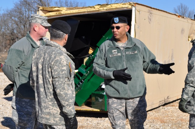 Col. Frank Y. Rangel Jr., commander of the 4th Maneuver Enhancement Brigade, discusses recovery measures taken by 193rd Brigade Support Battalion Soldiers following a tornado that struck their motor pool Dec. 31. The 193rd BSB is part of the 4th MEB whose mission is to respond to any large-scale domestic disaster that would require federal assistance.