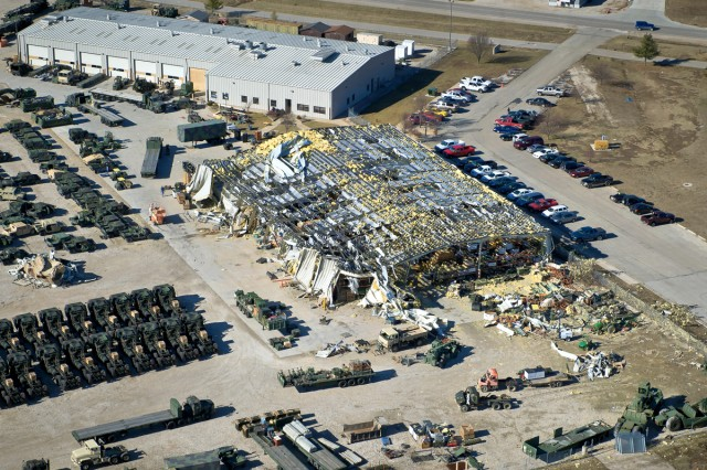 An aerial view from a UH-60 Black Hawk helicopter shows recent tornado damage to the motor pool area on Fort Leonard Wood, Mo., Jan. 3, 2011. A tornado struck the area New Year's Eve and also damaged several military homes.