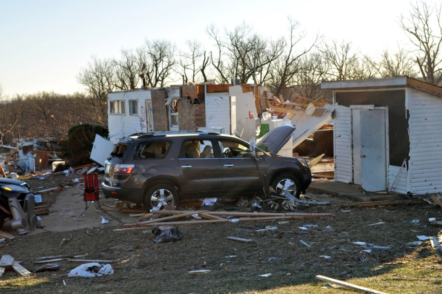 The collapsed home of Capt. Lamonte Russell on Fort Leonard Wood, Mo., is ready for him to retrieve personal belongings, Jan. 2, 2011. Russell, who was rescued from the building just after a tornado damaged military housing on New Year's Eve, is assigned to the 3rd Chemical Brigade.