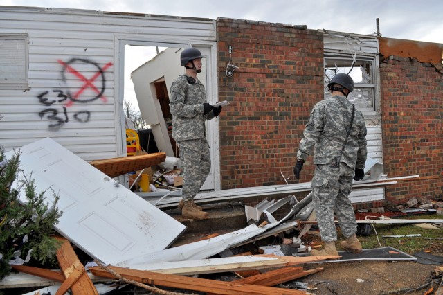 Sgt. Timothy Hanck leads members of a special reaction team as they assess damage to military housing after a tornado touchdown on Fort Leonard Wood, Mo., Dec. 31, 2010. Hanck, a military policeman, is assigned to the 252nd Military Police Detachment, 4th Maneuver Enhancement Brigade.
