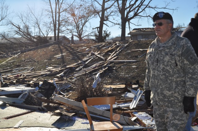 Army Chief of Staff Gen. George W. Casey Jr. observes damage caused to military housing from a tornado that struck Fort Leonard Wood, Mo., Dec. 31, 2010. More than 100 families were affected by the storm.