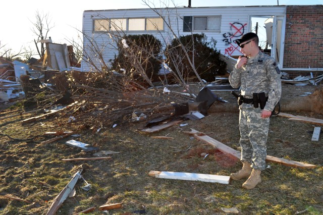 Sgt. Andrew Dean reports the status of a damaged military housing structure, Jan. 2, 2011, after a tornado touchdown on Fort Leonard Wood, Mo., Dec. 31, 2010. Dean, a military policeman assigned to the 463rd Military Police Company, 4th Maneuver Enhancement Brigade, was one of the first responders after a New Year's Eve tornado struck the post.