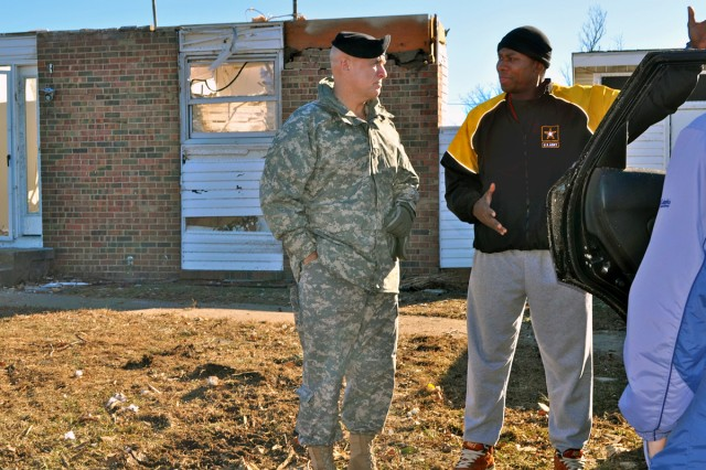 Maj. Gen. David E. Quantock, commanding general Fort Leonard Wood, and Maneuver Support Center of Excellence, speaks with Capt. Lamonte Russell, who was displaced after the New Year's Eve tornado that damaged several military houses on Fort Leonard Wood, Mo., Jan. 2, 2011. Russell is assigned to the 3rd Chemical Brigade. His home collapsed during the tornado.