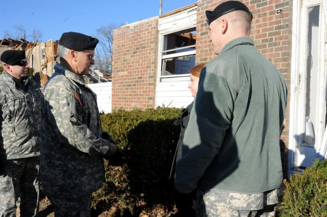 Army Chief of Staff Gen. George W. Casey Jr. speaks with Capt. Nathan Kaminski and his spouse, Louise, outside the remains of their home on Fort Leonard Wood, Mo., during his visit to to asses the damage and reassure the families who weathered the storm.