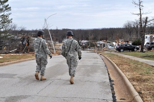 Soldiers assess damage to military housing following a tornado touchdown on Fort Leonard Wood, Mo., Dec. 31, 2010.