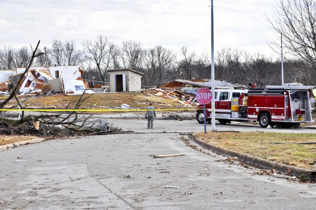 A Soldier conducts a traffic control point as local emergency responders assess damage to military housing following a tornado touchdown on Fort Leonard Wood, Mo., Dec. 31, 2010.