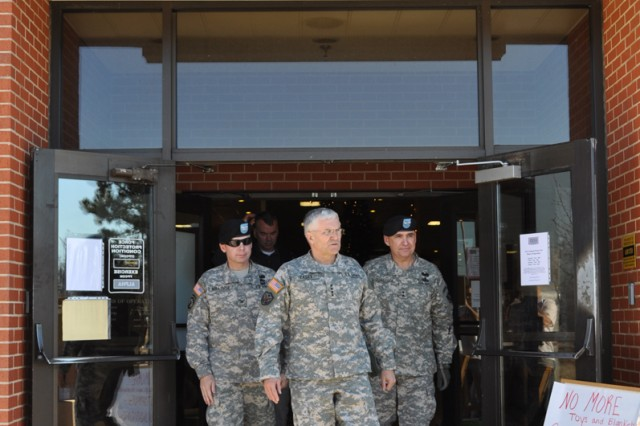 Army Chief of Staff Gen. George W. Casey Jr. exits the Fort Leonard Wood, Mo., USO after visiting with volunteers at the Army Community Service tornado family assistance center. More than 100 homes were affected by the Dec. 31, 2010 tornado.