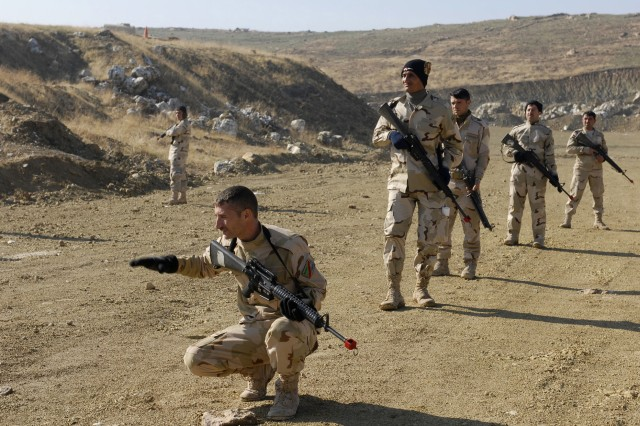 Soldiers assigned to 1st Battalion, 11th Brigade, 3rd Iraqi Army Division, practice squad movement drills at al-Ghuzlani Warrior Training Center, Iraq, Jan. 3.