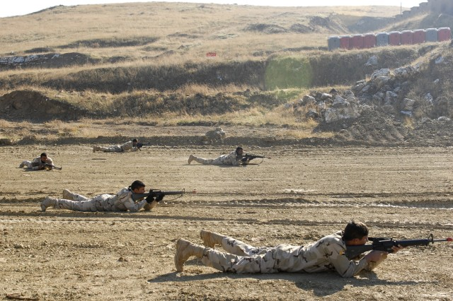 Soldiers assigned to 1st Battalion, 11th Brigade, 3rd Iraqi Army Division, secure an area after coming into simulated contact with enemy forces during squad movement drills at al-Ghuzlani Warrior Training Center, Iraq, Jan. 3.