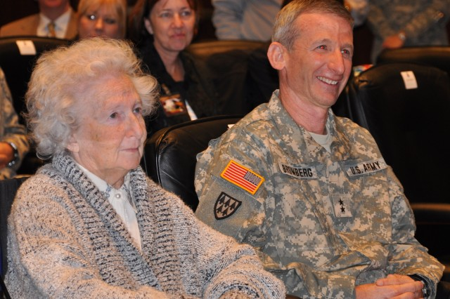 """FORT McPHERSON, Ga. (Jan. 4, 2011) - Prior to pinning on his new 3-star rank, Maj. Gen. (P) Howard B. Bromberg and his mother Bernice Bromberg listen to remarks given by Gen. James D. Thurman, commanding general of U.S. Army Forces Command. """"Getting promoted to Lt. Gen. is a real feather in someone's hat. There are only a handful of folks who wear the rank of a three-star general. It's less than 10 percent,"""" said Thurman."""