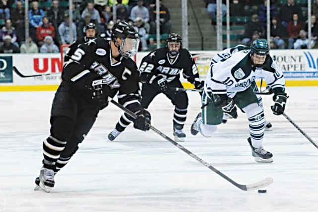 Army defenseman Zach McKelvie moves the puck up the ice in a 2009 game. He was the Black KnightsAca,!a,,c team captain as a junior and senior and wound up signing with the Boston Bruins as an undrafted free agent.