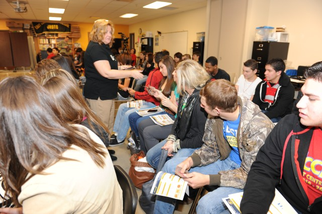 Karen Ryder, U.S. Army educational outreach coordinator, gives students at San Antonio's East Central High School a sample of food science technology -- a power bar.