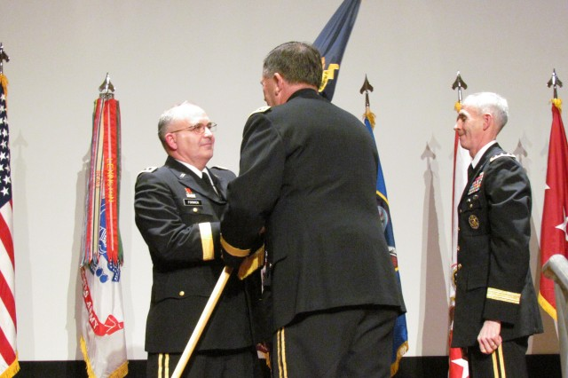 Lt. Gen. Richard Formica accepts the flag of command from vice chief of the staff of the Army Gen. Peter Chiarelli during the Space and Missile Command/Army Forces Strategic Command change of command ceremony. The traditional ceremony involved the passing of the flag from SMDC/ARSTRAT Command Sgt. Maj. Larry Turner and then to retiring commander Lt. Gen. Kevin Campbell, right, before being passed on to Chiarelli and then to Formica.
