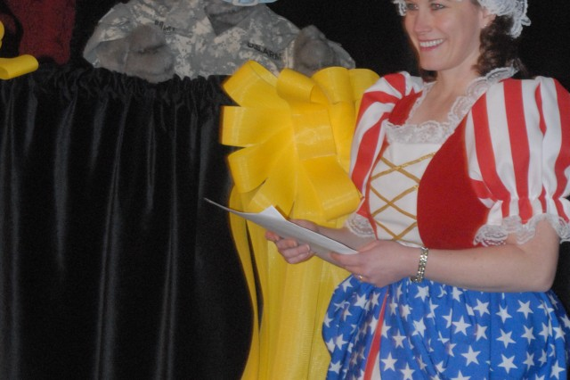Linda Liberty and Sergeant Rocky talk to children in the audience about their deployment concerns during the premiere presentation of Sergeant Rocky's Neighborhood  uppet Show at Club Stewart, March 23.
