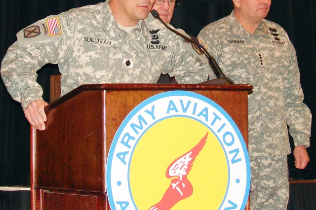 Lt. Col. Patrick Sullivan, commander of the UASTB, part of 1st Avn. Bde. and based at Fort Huachuca, Ariz., praises the efforts of his battalion while retired Brig. Gen. Rodney D. Wolfe, AAAA president and Gen. James D. Thurman, U.S. Army Forces Command commanding general, look on. Sullivan was presented with the UAS Unit of the Year award at a banquet honoring the UAS Unit of the Year and Soldier of the Year during the AAAA UAS Symposium in Arlington, Va., in December.