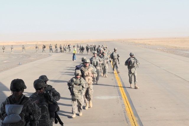 Task Force Marne Soldiers from 3rd Infantry Division board a C-17 scheduled to depart Contingency Operating Base Speicher, Iraq, Aug. 23. More than 100 Soldiers were part of the responsible drawdown of forces to 50,000 troops by the end of August 2010.