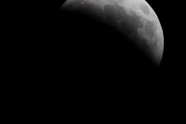 FORT WAINWRIGHT, Alaska - The moon is nearly dark as the eclipse progresses.