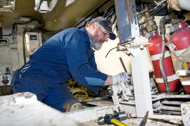 Doug Blumenschein dismantles a M88 in Anniston Army Depot's Combat Vehicle Repair Facility.