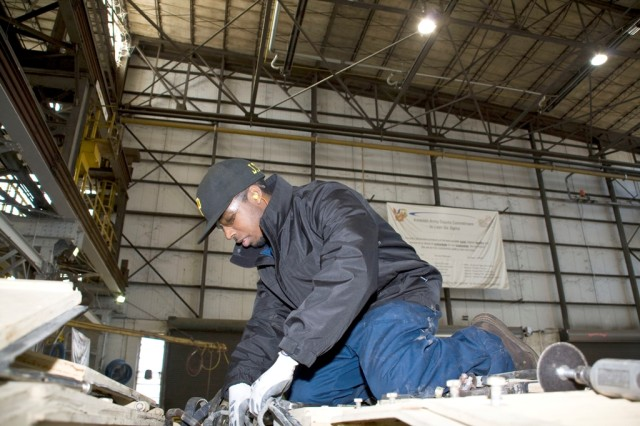 Jordan Tarver works on a M1 Abrams hull in Anniston Army Depot's Combat Vehicle Repair Facility.
