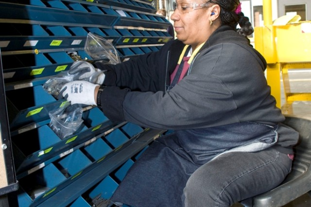 Gloria Robinson restocks parts in Anniston Army Depot's Combat Vehicle Repair Facility.