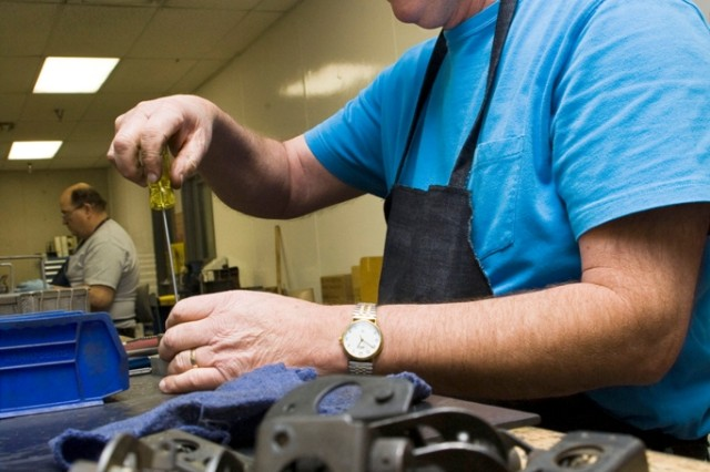 Charlie Woods assembles components for a M249 MG in Anniston Army Depot's Small Arms Repair Facility.