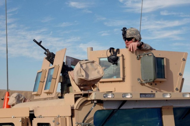 Soldiers use the Objective Gunner Protection Kit mounted on an M114 Humvee in Iraq. The OGPK was named one of the Army's 10 Greatest Inventions for 2007.
