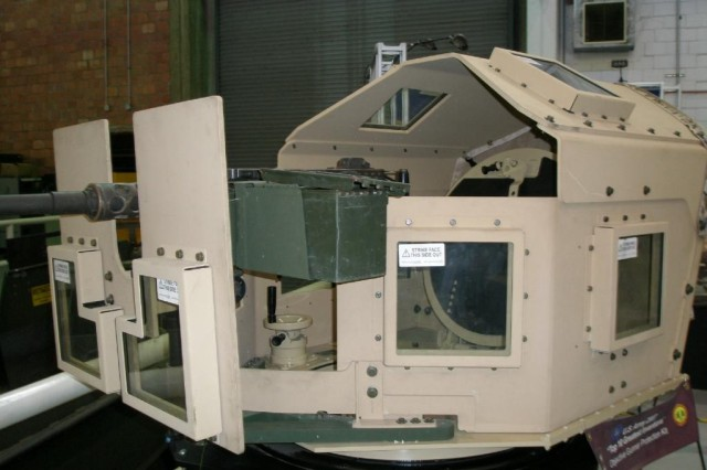 The ballistic grade Overhead Cover was designed at Picatinny Arsenal to fit the Objective Gunner Protection Kit with minimial tools and assembly time for the Soldier. The Overhead Cover was named one of the Army's 10 Greatest Inventions of 2008.