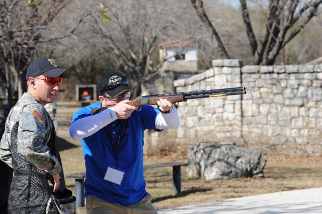 Sgt. Vincent Hancock of the Army Marksmanship Unit assists Hunter Crandall, of Cisco Systems U.S. Federal Organization, in skeet shooting at the San Antonio Gun Club, Jan. 6. Crandall was one of 87 distinguished guests U.S. Army Accessions Command hosted for the U.S. Army All-American Bowl game, Jan. 8.