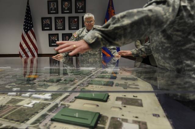 Chief of Staff of the US Army, Gen. George W. Casey Jr., is shown a model of the Corpus Christi Army Depot during his visit on Jan. 10, 2011.  The depot is currently the largest facility of its type in the world.