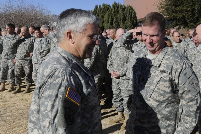Chief of Staff of the US Army, Gen. George W. Casey Jr., and Sgt. Maj. of the Army, Kenneth O. Preston talk outside the Command Sergeant Major Conference in Ft. Bliss, TX, Jan. 10, 2011.