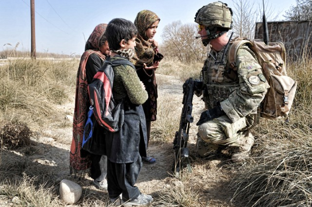 Afghan children alert British Cpl. Martin, from 23 Pioneer Regiment, Royal Logistics Corps, of a mine 100 meters away.