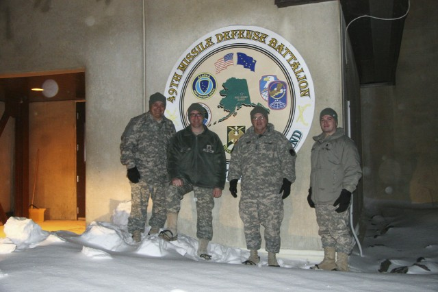 (from left to right) Sgt. Maj. John Mattie, Operations Sergeant Major; Command Sgt. Maj. Bradford Quigley, Command Sergeant Major,  49th Missile Defense Battalion; Lt. Gen. Richard Formica, Commanding General, U.S. Army Space and Missile Defense Command/Army Forces Strategic Command; and Lt. Col. Joseph Miley, Commander, 49th Missile Defense Battalion, pause on an especially cold and windy day at the Missile Defense Complex at Fort Greely, Alaska. During his visit the commanding general saw ambient temperatures of 33 degrees below zero and wind gusts of 25 miles per hour on the post that houses the more than 200 Alaska Army National Guard Soldiers and the missile defense system. (Photo by Staff Sgt. Jack W. Carlson III, 49th Missile Defense Battalion)