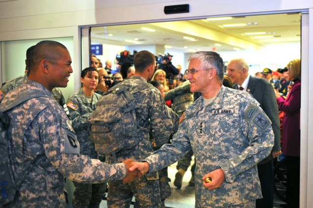 "Chief of Staff of the US Army, Gen. George W. Casey Jr., greets a Soldier at Dallas/Fort Worth International Airport who's returning from his deployment to begin his two week ""rest and recuperation"" (R&R) time on Jan. 11, 2011. The U.S. Military R&R program today observed the one-millionth soldier transported home from Iraq and Afghanistan."