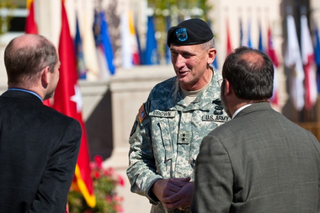 Maj. Gen. Robert Brown shakes hands with attendees at Fort Benning's Veterans Day ceremony in November. On Thursday, Brown discussed progress with the Maneuver Center of Excellence and the brisk pace set in order to meet the Sept. 15 deadline for full operating capacity.