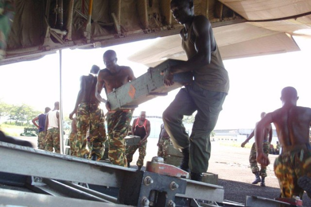 Burundian Defense Force soldiers hand load materiel during a deployment capability assessment visit to Bujumbura Military Airfield, Burundi, by U.S. Army Africa logisticians, Dec. 14-17, 2010